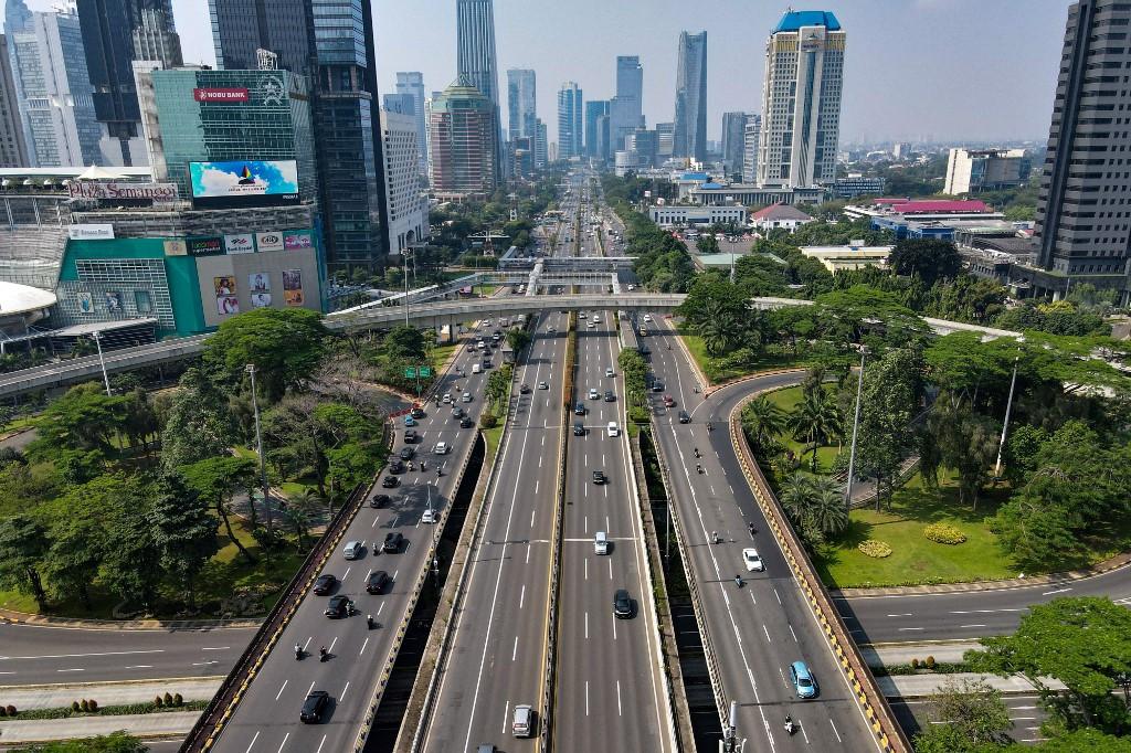 Tougher COVID-19 curbs begin as virus cases skyrocket in Indonesia