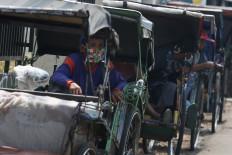 Pekerja informal di Asia Tenggara: tanpa sumber daya, tetapi banyak akal