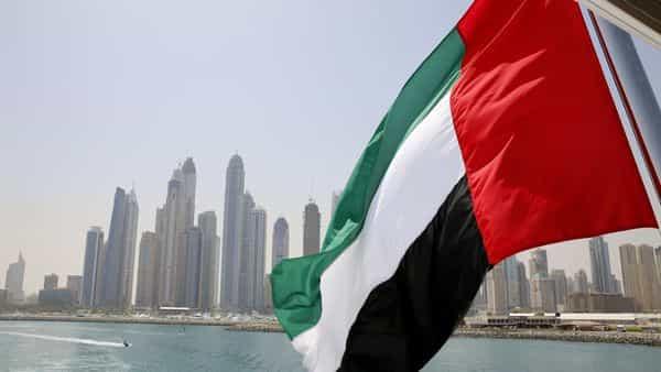 UAE flag flies over a boat at Dubai Marina, Dubai, United Arab Emirates (REUTERS)